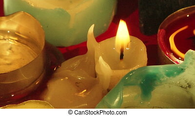 candles - some candle ends fired in the dark
