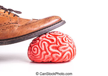 human brain under a business man feet, isolated on white