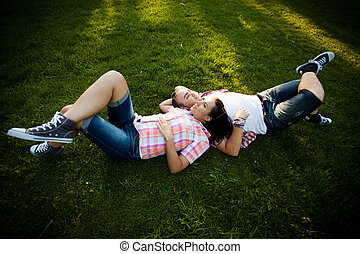 legs, couple, laughing, grass - cheerful young couple...