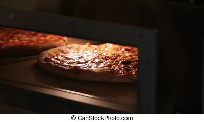 Ready pizza getting from oven and close Oven - Ready pizza...