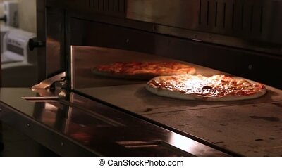 Pizza frying in the oven and close Oven, traditional...
