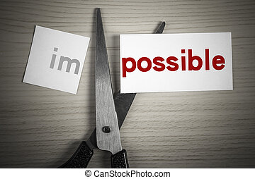 Cut possible from impossible - A scissor is cuting possible...