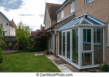 Conservatory and view of back graden