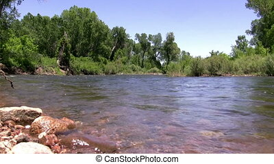 (Perfect Loop) Flowing Downstream - The river flows...