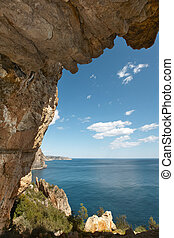 Mediterranean coastline landscape with cave in Alicante. Spain