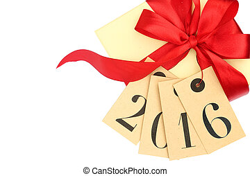 Gift box with red bow and tags with new year 2016 isolated...
