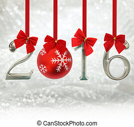 2016 number ornaments hanging on red ribbons in a glittery...