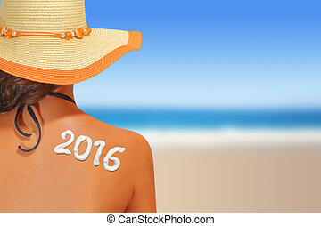 2016 written on woman's back