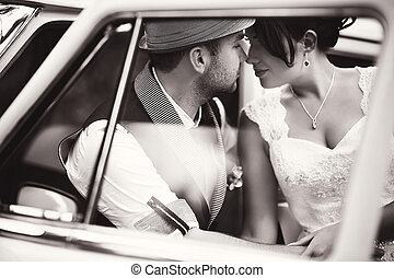 Wedding couple in car - Stylish Autumn wedding a beautiful...
