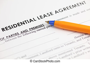 Lease Agreement - Lease agreement and ballpoint pen Close-up...