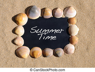 Summer time. - Blackboard on beach sand with the phrase...