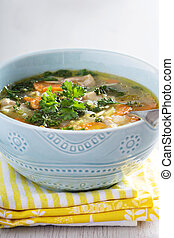 Lemon pasta chicken soup with orzo and parsley