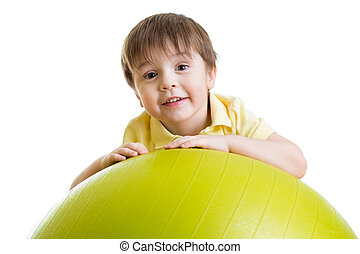 child boy doing fitness exercise with fitness ball