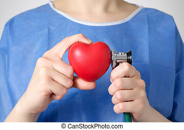 Doctor examining a heart - Red heart and stethoscope in the...