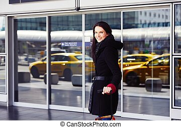 Woman at the airport - Successful woman in front of the...