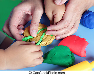 Child and mother playing with playdough - Childrens and...