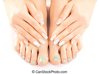 beautiful feet with turquoise pedicure isolated - Closeup...