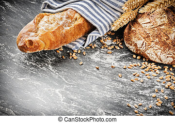 Freshly baked bread and baguette in rustic setting