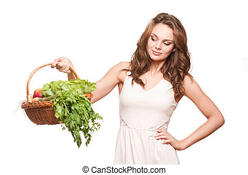 Healthy food. - Gorgeous young brunette woman with a basket...