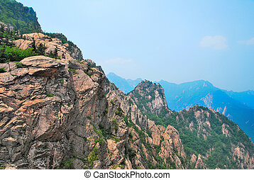 Treacherous mountain cliffs with pointed and jagged edges....