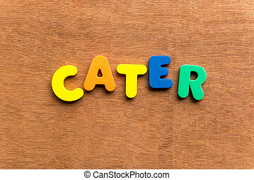 cater colorful word on the wooden background