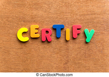 certify colorful word on the wooden background