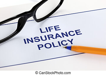 Life insurance policy with glasses and ballpoint pen.