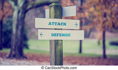 Rustic wooden sign in an autumn park with the words Attack - Def