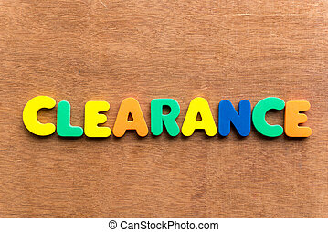 clearance colorful word on the wooden background