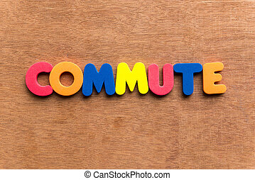 commute colorful word on the wooden background