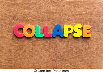 collapse colorful word on the wooden background