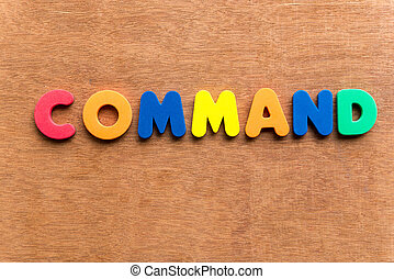 command colorful word on the wooden background