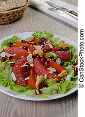 Salad of lettuce with fruits and nuts - Salad of grapefruit...