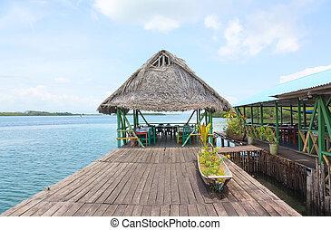 Tropical restaurant on the stilts - Tropical bar on the...