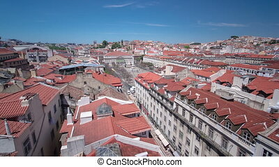 Rossio square in the central Lisbon with a monument of the...