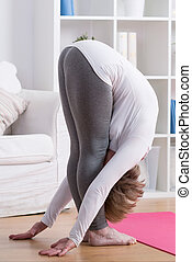 Stretched lady bending down - Picture of stretched mature...