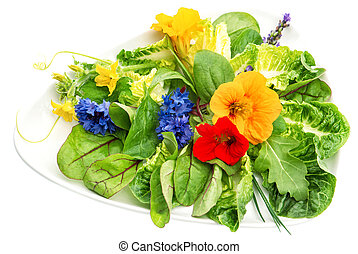 Fresh green salad with edible garden flowers. Healthy food
