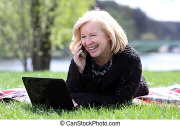 portrait of a happy mature woman calling by phone