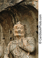 Anscient Buddhist cave statue near Luoyan city, China. -...