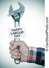 man with adjustable wrench and signboard with text happy...
