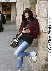 woman outdoors talking on mobile phone