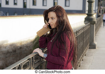 attractive young woman with mobile phone