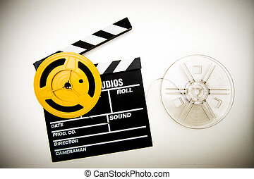 Movie clapper board and super 8 mm reels vintage color effect