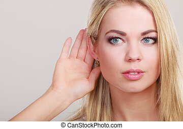 gossip girl with hand behind ear spying - Female hand to ear...