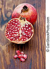 Fresh pomegranates on a wooden board