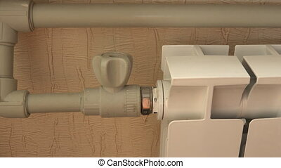 Optimal Setting of the Thermostat Valve. Radiator Adjustment to Save Energy. Radiator and thermostatic valve.