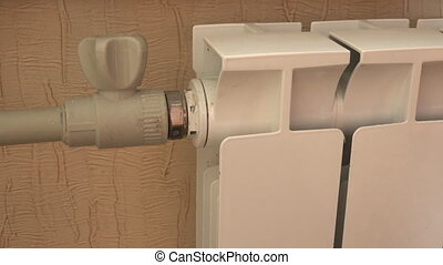 Optimal Setting of the Thermostat Valve. Radiator Adjustment...