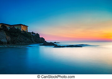 Castiglioncello old building on the rocks and sea on sunset...