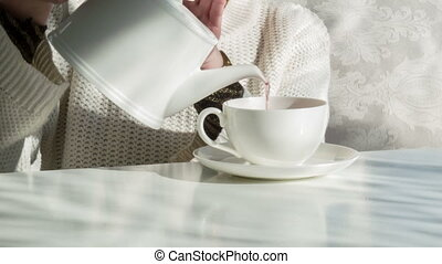 Good time for drinking tea - Hot tea Woman wearing white...