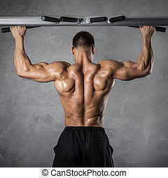 Pull-up exercise - Brutal athletic man making pull-up...